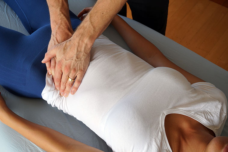 Abdominal massage therapy performed on a customer at Andrew's Auckland clinic.
