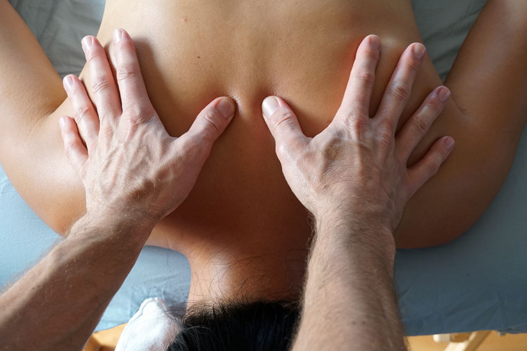 Therapeutic massage therapy on the upper back and shoulders.